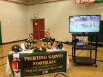 Calen and Mike manning the football booth, February 2015.